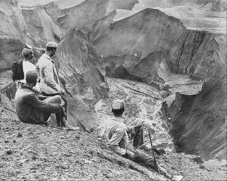 Local men observe volcanic deposits flowing through a watercourse in the north of St. Vincent following the May 7, 1902 eruption.