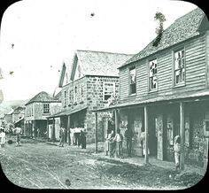 Broken windows and ash-covered streets in Georgetown following the 1902 eruption.