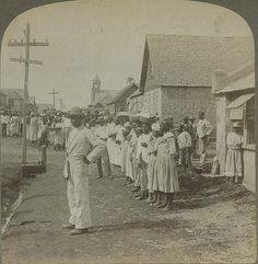 Supplies being distributed to persons seeking refuge during the 1902 eruption of neighboring La Soufriere volcano - Georgetown, 1902.