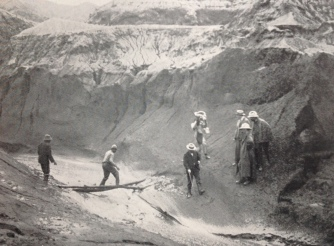 A post-eruption assessment team is seen crossing the Wallibou River, north of Richmond, following the 1902 volcanic eruption.